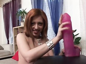 Dildo Sucking Redhead Sits Her Snatch Down On The Toy
