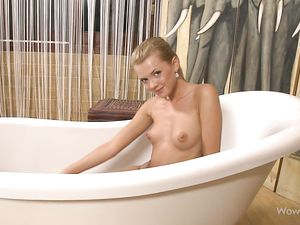 Perky Breasts Teen Cutie Oiling Up In The Tub